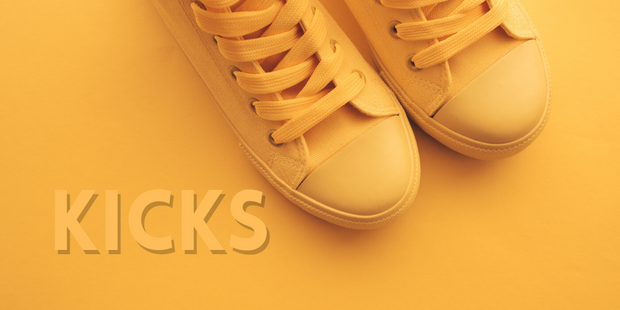 Yellow shoes on a yellow background